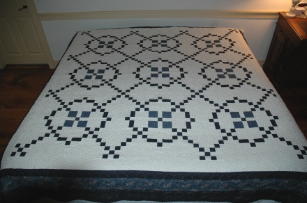 Quilt on king-size bed brightened